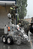STK108868M © Stocktrek Images, Inc. U.S. Soldiers guide the Andros F6-A robot in South Korea.
