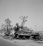 STK500532A © Stocktrek Images, Inc. Wreckage of a General Sherman tank and a German 88mm gun, Sicily, 1943.