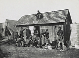 STK500899A © Stocktrek Images, Inc. Civil War soldiers in front of their wooden hut, circa 1863.