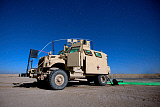 TMO101149M © Stocktrek Images, Inc. A MaxxPro MRAP vehicle under a starry sky.