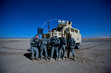 TMO101156M © Stocktrek Images, Inc. Medical personnel pose for a group photo around their MRAP vehicle.