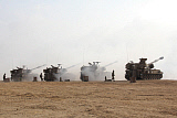 ZDN100205M © Stocktrek Images, Inc. M109 self-propelled howitzers firing in the Negev Desert, Israel.