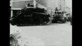 NAR800170F © Stocktrek Images, Inc. Wide shot of military tanks moving on street im Normandy, France.