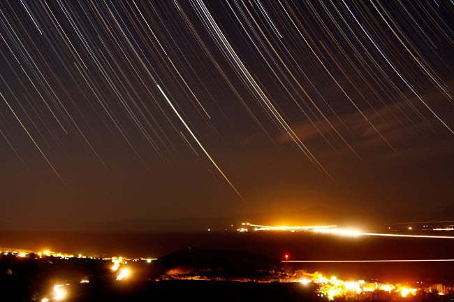 AAM200003S © Stocktrek Images, Inc. Star trails above a village in the central desert of Iran.