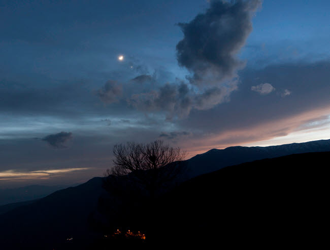 AAM200006S © Stocktrek Images, Inc. Moon and Venus conjunction above the village of Gazorkhan, Iran.