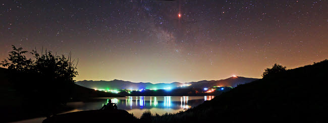 AAM200008S © Stocktrek Images, Inc. Lunar eclipse and Milky Way above Taleqan Lake, Iran.