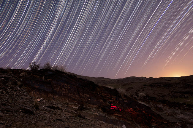 AAM200009S © Stocktrek Images, Inc. Star trails and rock art in the central province of Iran.