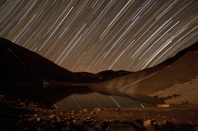 AAM200010S © Stocktrek Images, Inc. Star trails above Taar Lake, near Tehran, Iran.