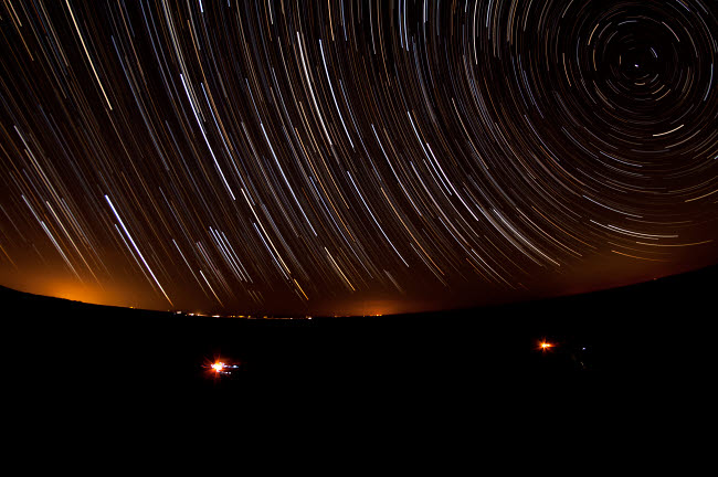 AAM200012S © Stocktrek Images, Inc. Star trails above a dark Maranjab Desert, Iran.