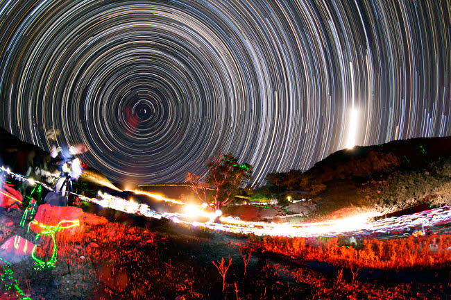 AAM200014S © Stocktrek Images, Inc. Astronomers observe polar star trails above a mountain in Iran.