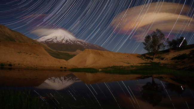 AAM200016S © Stocktrek Images, Inc. Star trails above Mount Damavand, Iran.