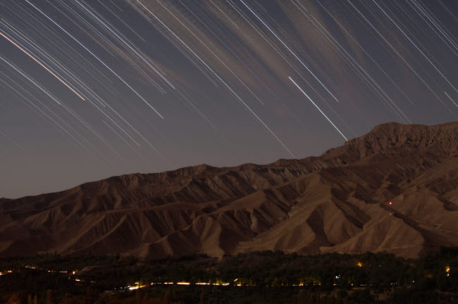 AAM200021S © Stocktrek Images, Inc. Star trails above a valley in the Firoozkooh area, Iran.