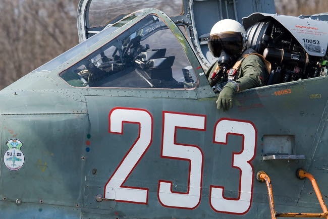 ABA100006M © Stocktrek Images, Inc. A pilot sitting in the cockpit of a Sukhoi Su-25 aircraft.