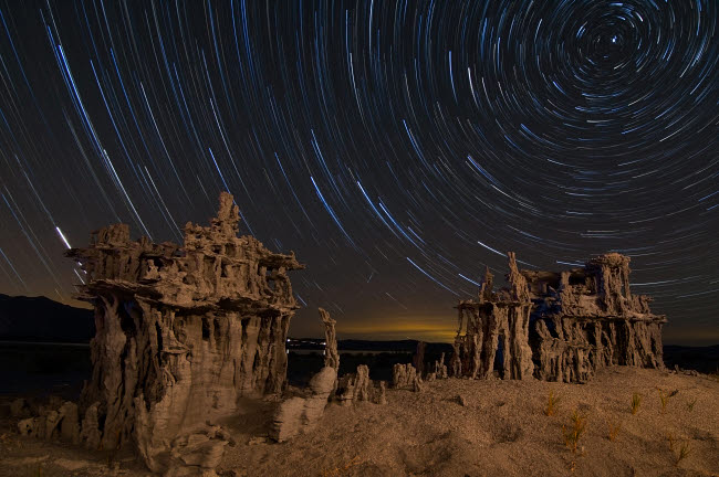 BRR200015S © Stocktrek Images, Inc. Star trails and intricate sand tufa formations at Mono Lake, California.