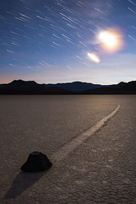 BRR200034S © Stocktrek Images, Inc. Star trails at the Racetrack Playa in Death Valley National Park, California.