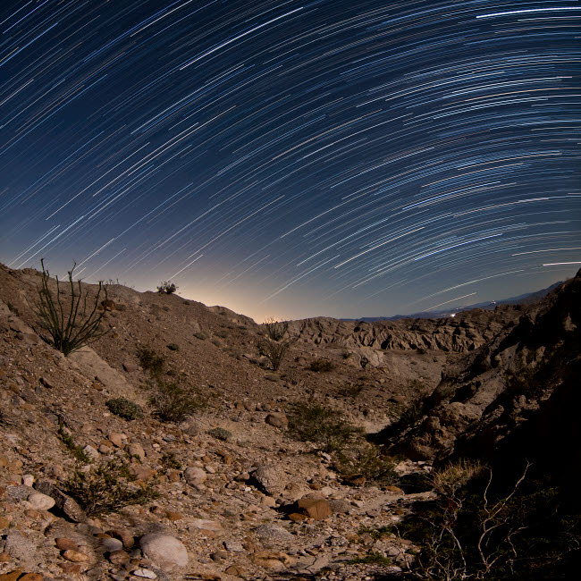 BRR200054S © Stocktrek Images, Inc. Star trails over the rugged canyon in Anza Borrego Desert State Park, California.