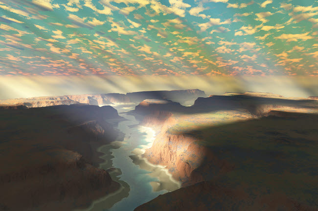CFR100283S © Stocktrek Images, Inc. Sunrays shine down on mist over a canyon river in a desert wilderness.