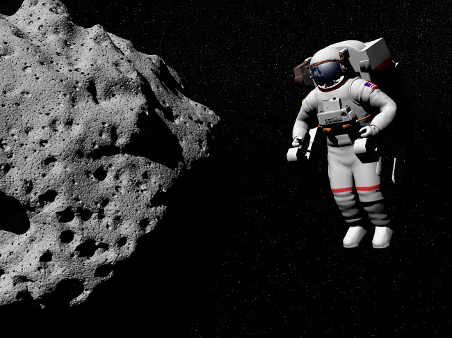 EDV200032S © Stocktrek Images, Inc. Astronaut exploring an asteroid in outer space.