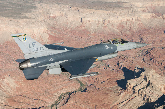 ERK100018M © Stocktrek Images, Inc. F-16C Fighting Falcon flying over the Grand Canyon, Arizona.