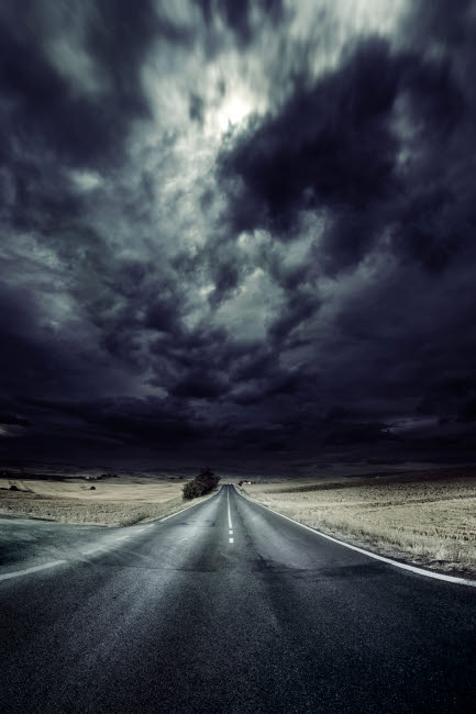EVK200200S © Stocktrek Images, Inc. An asphalt road with stormy sky above, Tuscany, Italy.