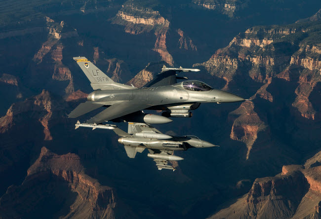 HGP100220M © Stocktrek Images, Inc. Two F-16's fly in formation over the Grand Canyon, Arizona.