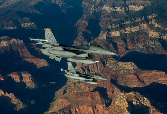 HGP100221M © Stocktrek Images, Inc. Two F-16's fly in formation over the Grand Canyon, Arizona.