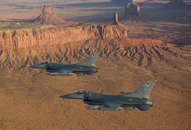 HGP100222M © Stocktrek Images, Inc. Two F-16's fly in formation over Northern Arizona.