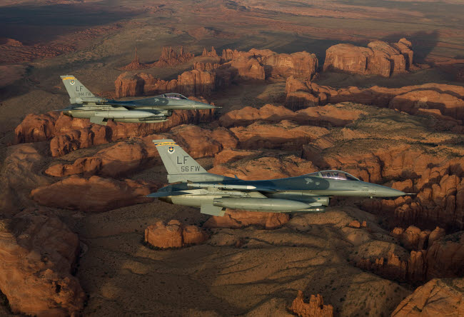 HGP100223M © Stocktrek Images, Inc. Two F-16's fly in formation over Northern Arizona.