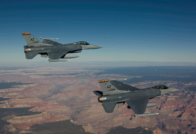 HGP100233M © Stocktrek Images, Inc. A pair of F-16's fly in formation near the Grand Canyon, Arizona.