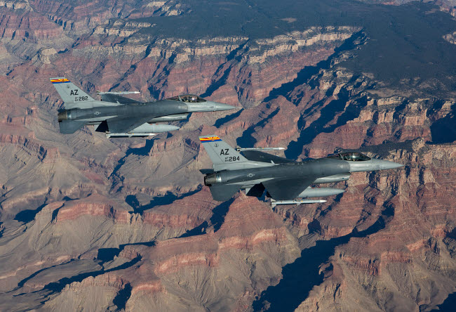 HGP100234M © Stocktrek Images, Inc. A pair of F-16's fly in formation near the Grand Canyon, Arizona.