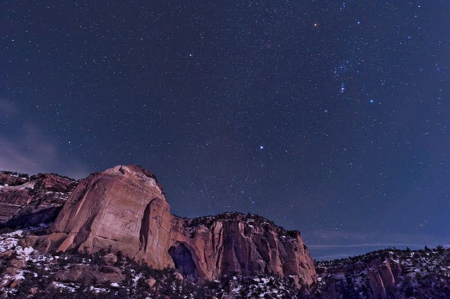 JDA100001S © Stocktrek Images, Inc. La Ventana arch with the Orion constellation rising above.