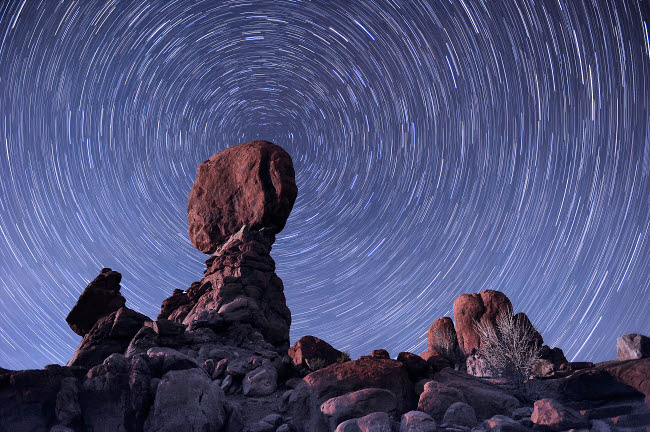 JDA100046S © Stocktrek Images, Inc. Star trails around the northern pole star, Arches National Park, Utah.