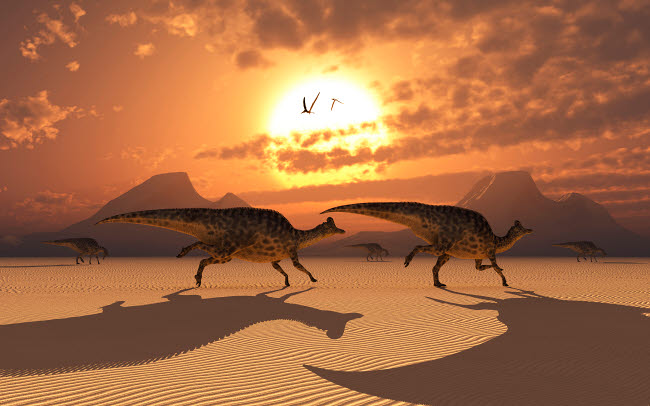 MAS100925P © Stocktrek Images, Inc. A herd of Velafrons Hadrosaur dinosaurs during the Cretaceous Period.
