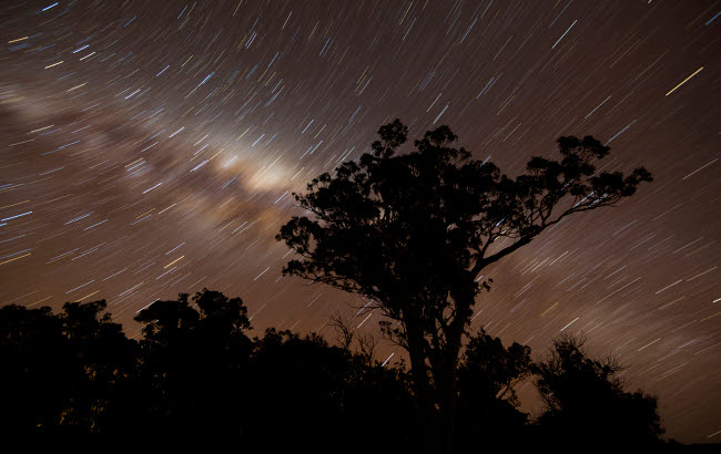PHA100038S © Stocktrek Images, Inc. Star trails and the Milky Way, Glenmaggie, Victoria, Australia.