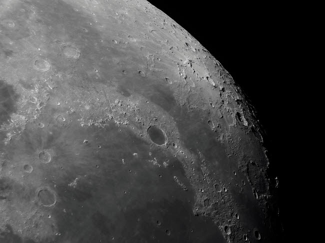 RGE100037S © Stocktrek Images, Inc. Close-up view of the moon showing impact crater Plato.