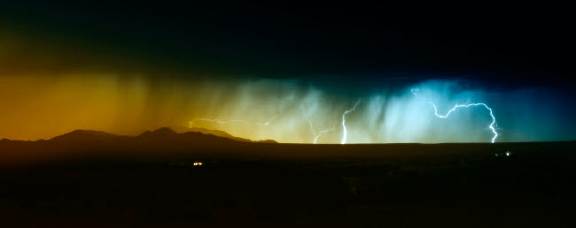 RIT100016S © Stocktrek Images, Inc. Lightning storm over northern New Mexico plains.