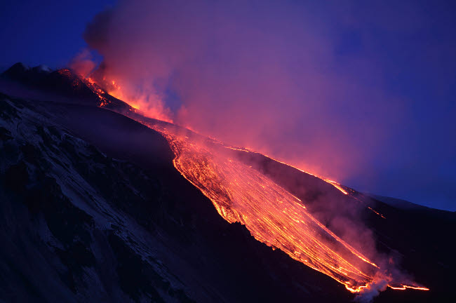 RRS300417S © Stocktrek Images, Inc. Lava flowing into Valle del Bove at Mount Etna Volcano, Italy.