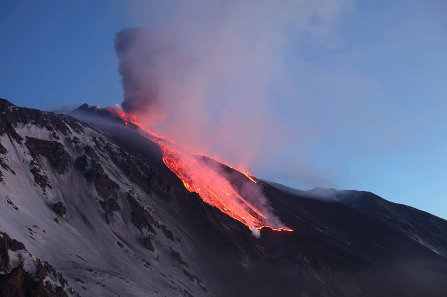 RRS300418S © Stocktrek Images, Inc. Lava flowing into Valle del Bove at Mount Etna Volcano, Italy.