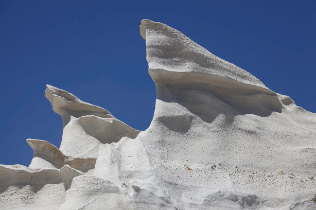 RRS300438S © Stocktrek Images, Inc. Sarakiniko white tuff formations sculpted by erosion, Milos, Greece.