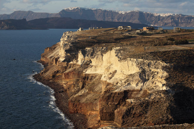 RRS300464S © Stocktrek Images, Inc. Cliffs of Cape Apronisi covered with tuff deposits from the Minoan Eruption of Santorini Volcano.