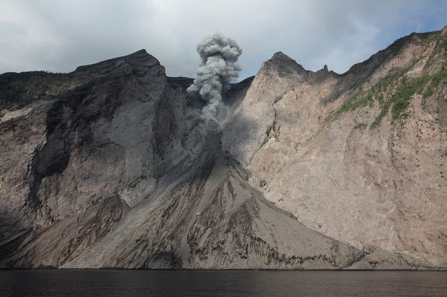 RRS300489S © Stocktrek Images, Inc. Active crater and debris slope below at Batu Tara volcano, Indonesia.