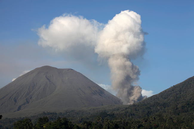RRS300543S © Stocktrek Images, Inc. Ash cloud rising from Tompaluan crater at Lokon-Empung volcano.