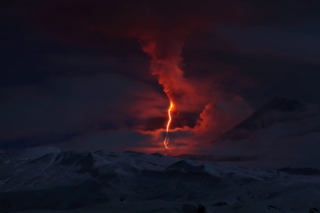 RRS300563S © Stocktrek Images, Inc. Nighttime eruption of Kliuchevskoi Volcano, Russia.