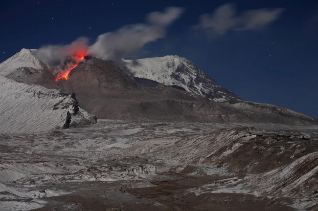 RRS300565S © Stocktrek Images, Inc. Incandescent rockfall of glowing lava down flank of Shiveluch Volcano.