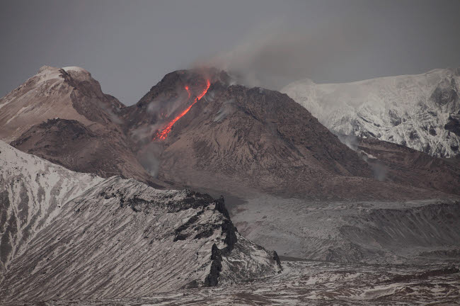 RRS300567S © Stocktrek Images, Inc. Incandescent rockfall of glowing lava down flank of Shiveluch Volcano.