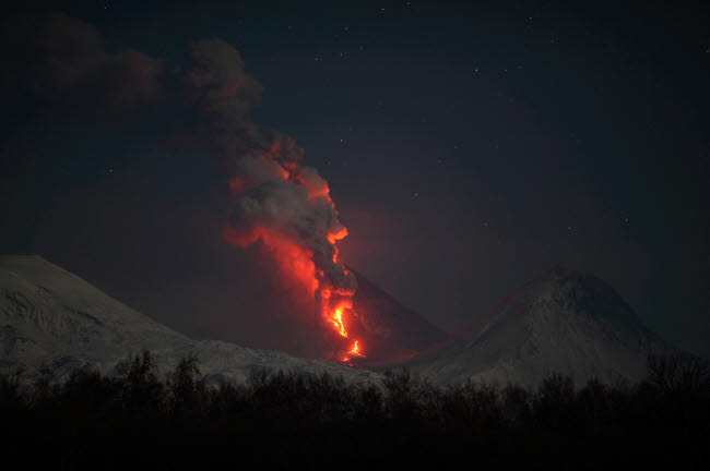RRS300570S © Stocktrek Images, Inc. Nighttime eruption of Kliuchevskoi Volcano, Russia.