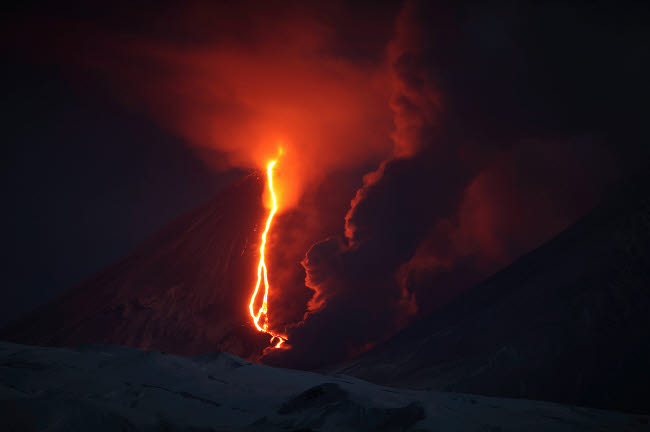 RRS300572S © Stocktrek Images, Inc. Nighttime eruption of Kliuchevskoi Volcano, Russia.