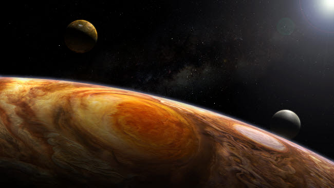 SHB100008S © Stocktrek Images, Inc. Jupiter's moons Io and Europa hover over the Great Red Spot on Jupiter.