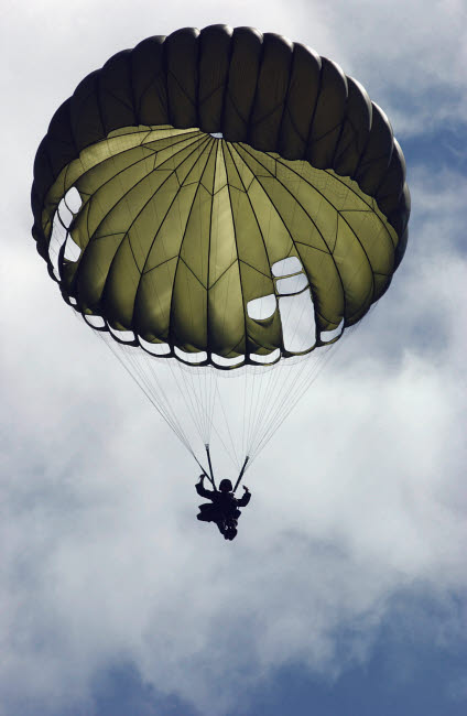 STK102214M © Stocktrek Images, Inc. An Armed Forces of the Philippines paratrooper wearing an MC1-C parachute descends through the sky.