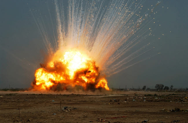 STK102224M © Stocktrek Images, Inc. A cache of unexploded ordnance is detonated.